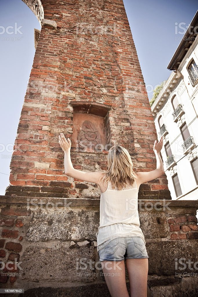 Blond Girl Praying To Madonna Bas-Relief royalty-free stock photo