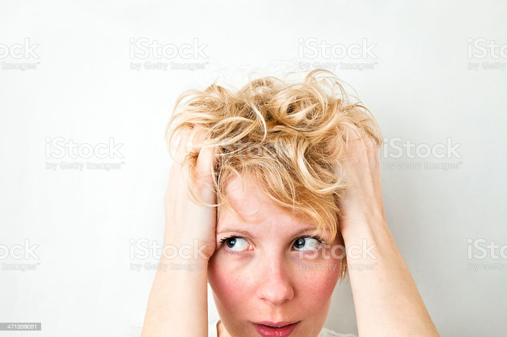 Blond Girl Pulling Hairs and looking left stock photo