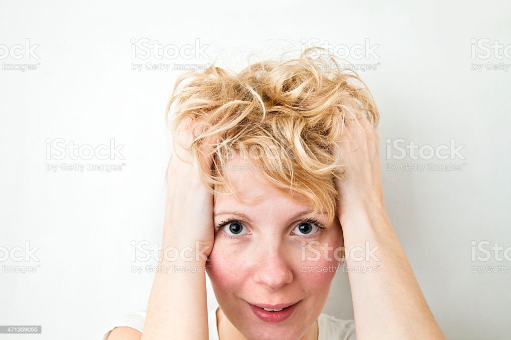 Blond Girl Pulling Hairs royalty-free stock photo