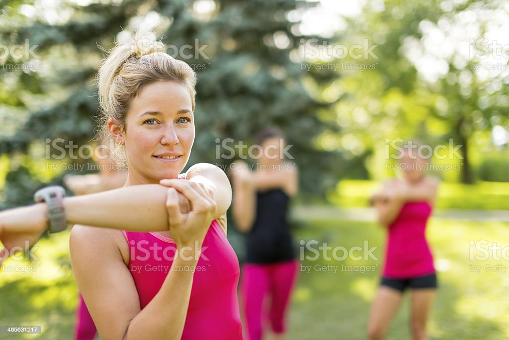 blond girl streching her arms stock photo