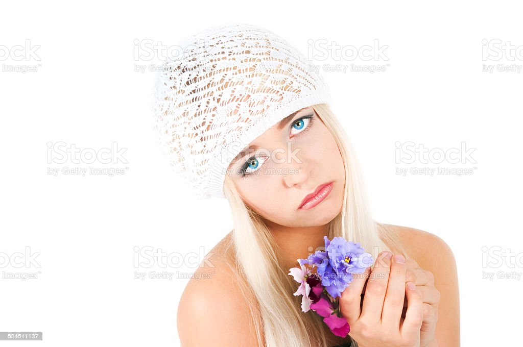 blond girl with a bouquet of violets stock photo