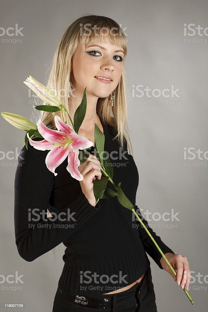 blond girl with flowers stock photo