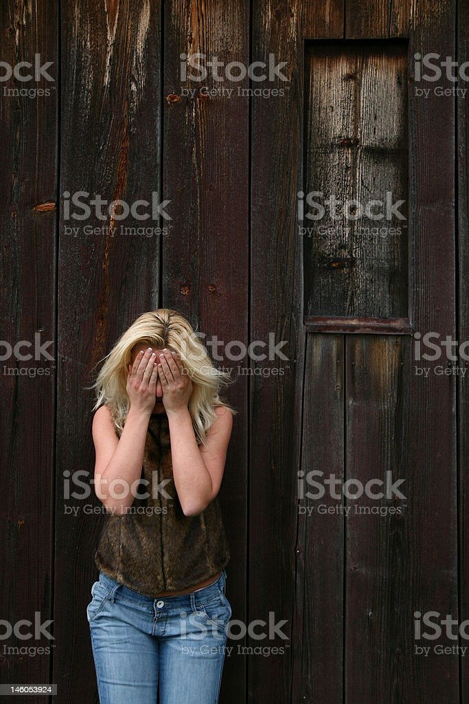 Blond Girl with Head In Hands royalty-free stock photo