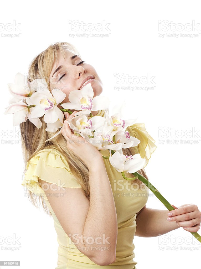 Blond girl with orchid stock photo