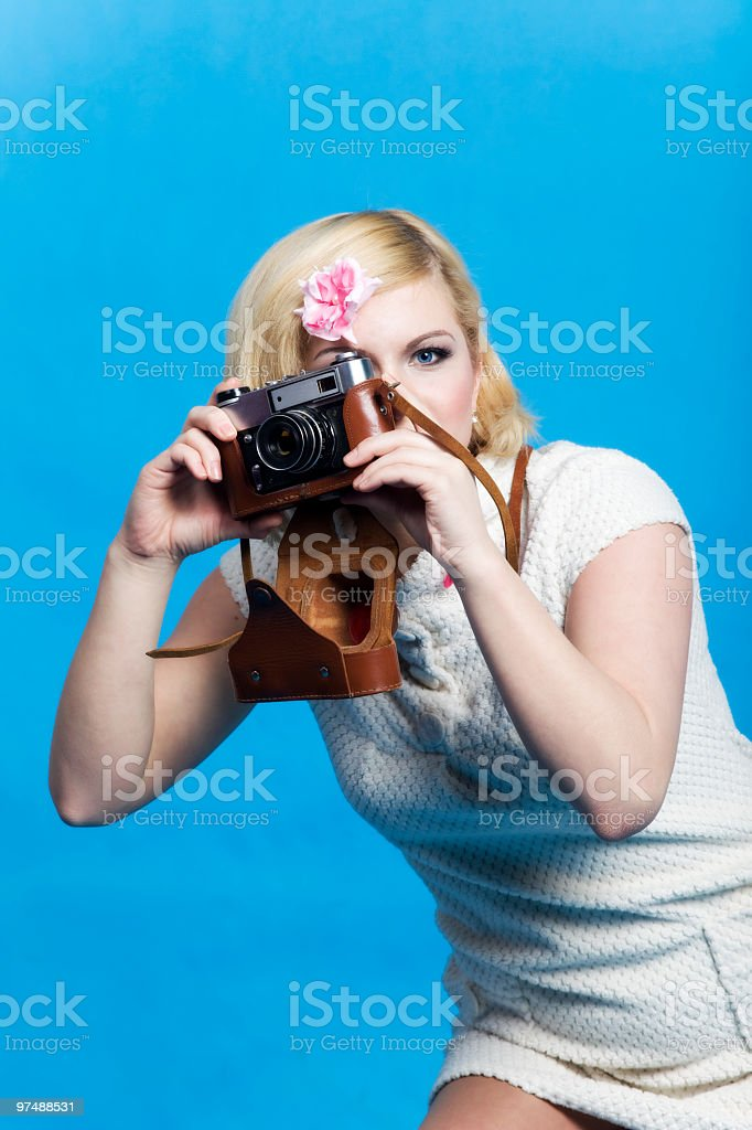 Blond girl with retro camera look at you stock photo