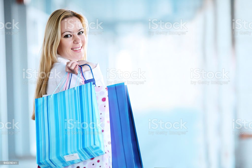 Blond girl with shopping bags. royalty-free stock photo