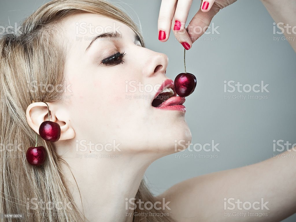 Blond Girl with Summer fruits stock photo