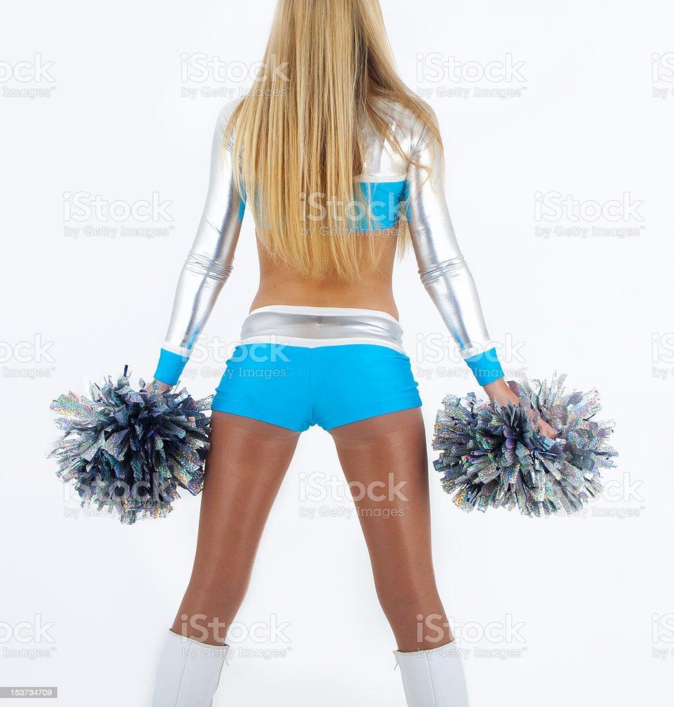 Blond hair cheerleader in silver-blue uniform. royalty-free stock photo
