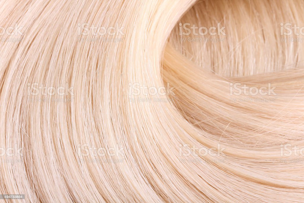 Blond hair extension stock photo