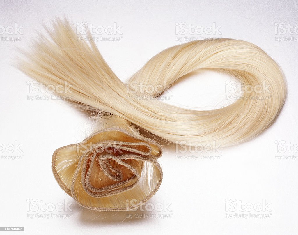blond hair piece cut out on white stock photo