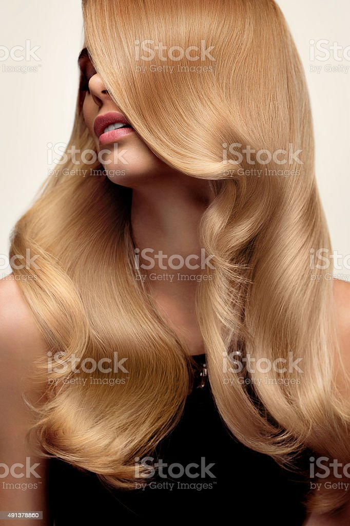 Blond hair. Portrait of beautiful Blonde with Long Wavy Hair. stock photo