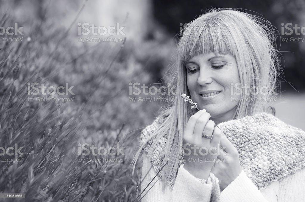 Blond Hair Woman in a Garden stock photo
