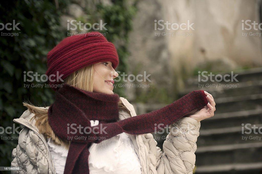 Blond Hair Woman Wearing Warm Clothings in an Ornamental Garden stock photo