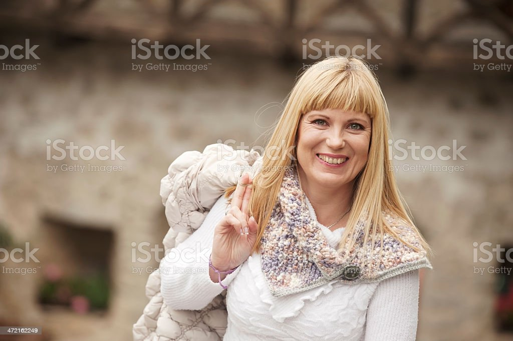 Blond Hair Woman with Scarf in an Old Village royalty-free stock photo