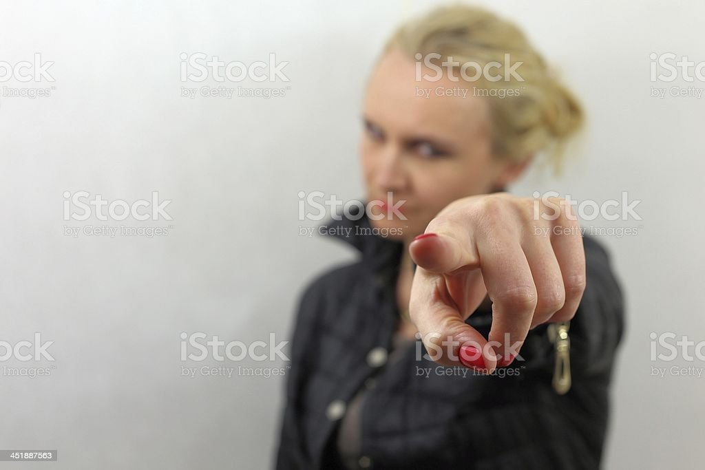 Blond haired woman points at you royalty-free stock photo