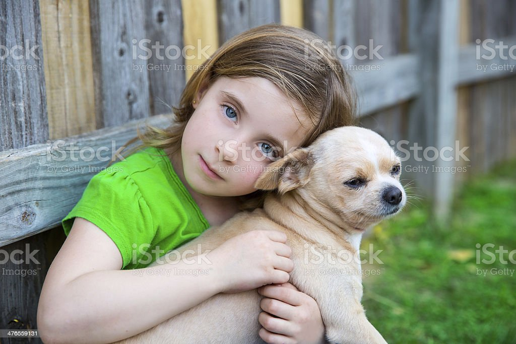 Blond happy girl with her chihuahua doggy portrait royalty-free stock photo