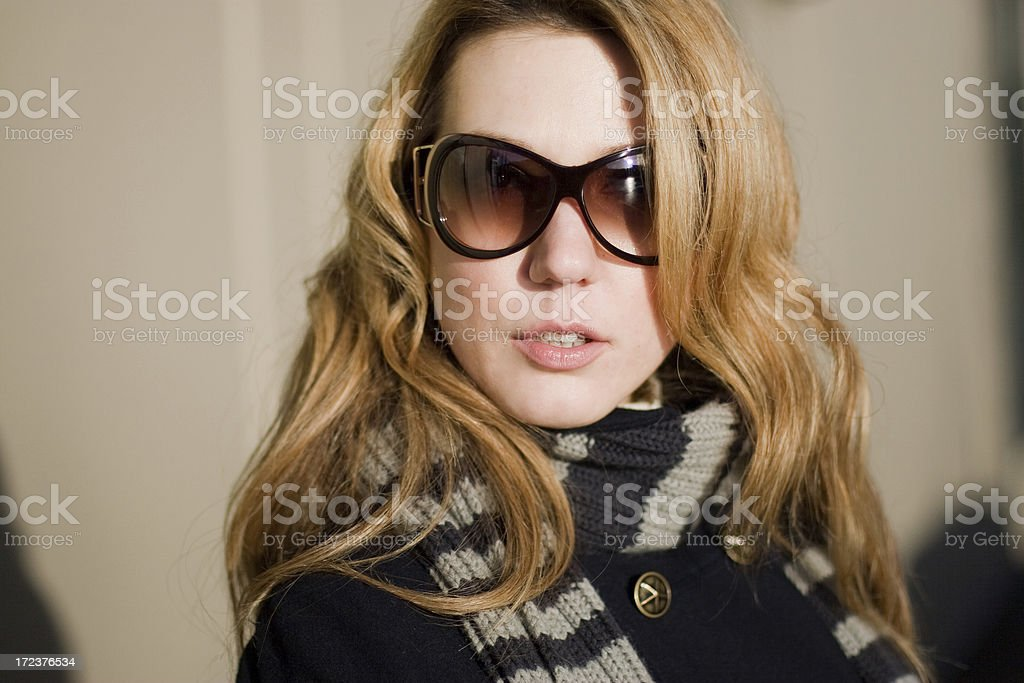 Blond in sunglasses stock photo