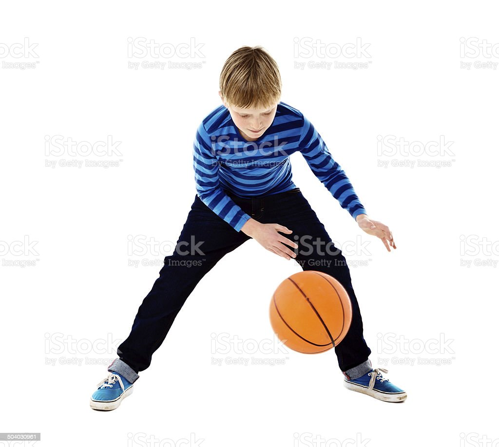 Blond schoolboy bouncing basketball. Isolated on white. stock photo