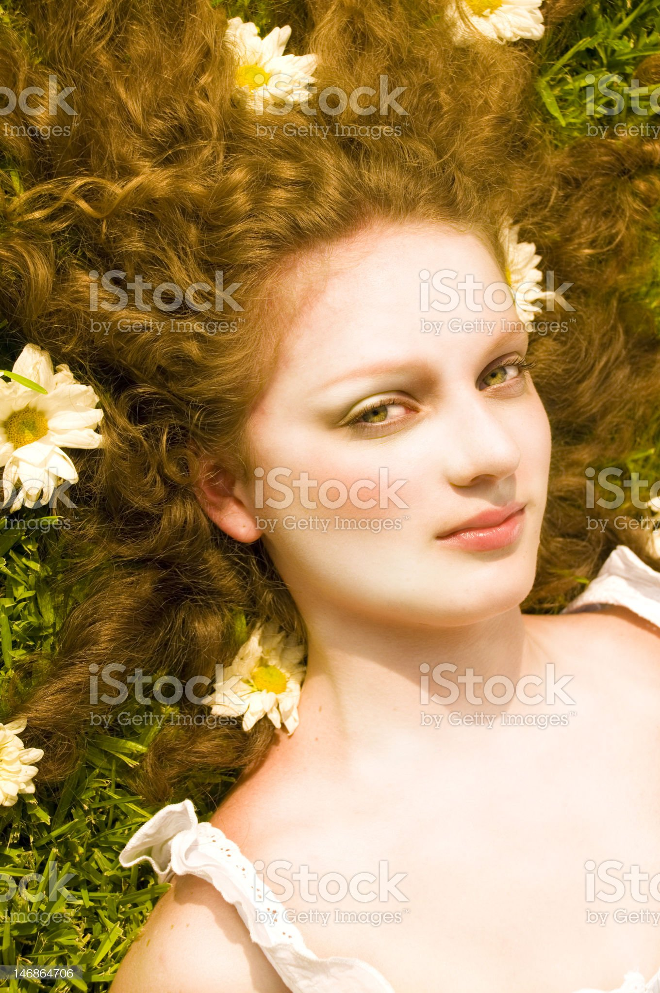 Blond teen lying on the grass royalty-free stock photo