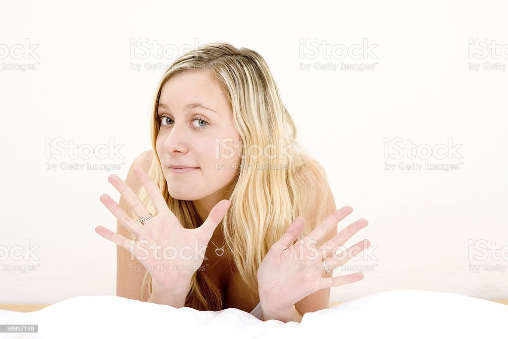 Blond teenage girl gesturing stock photo