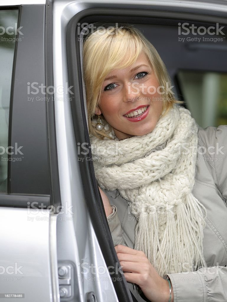 blond teenager looking out of her car stock photo