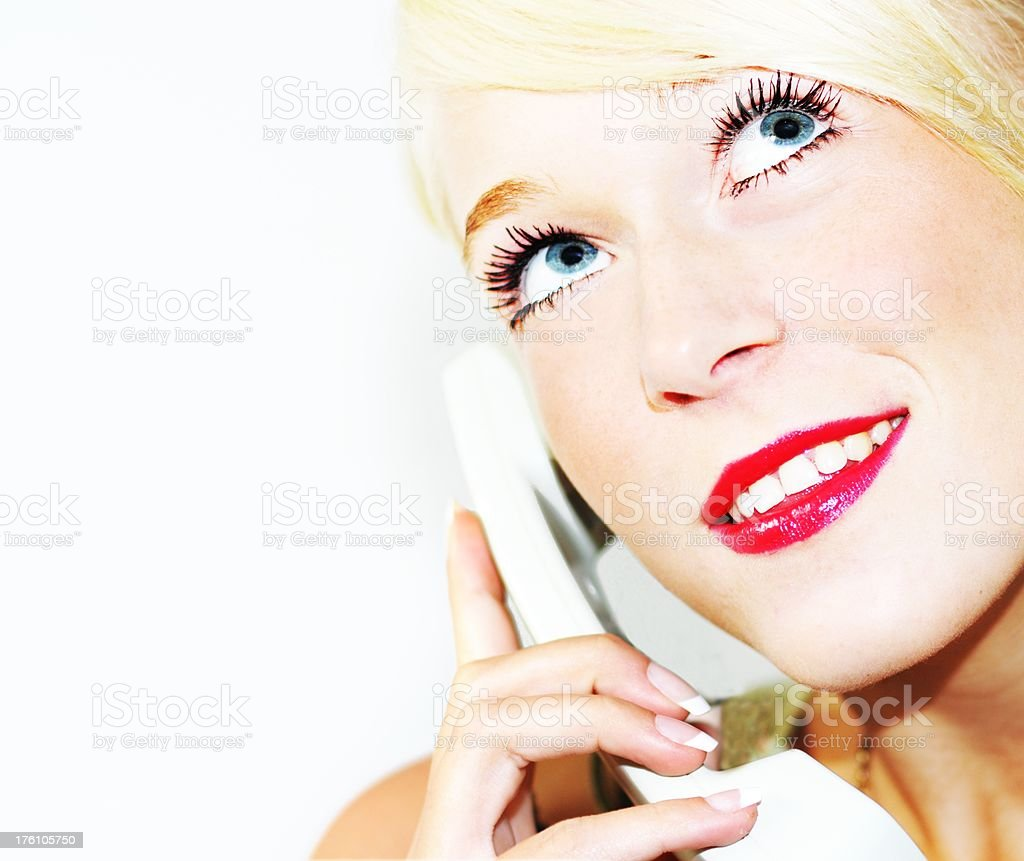 blond teenager with wide open blue eyes on the phone royalty-free stock photo