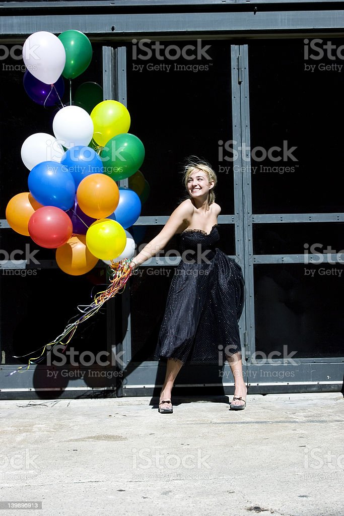 Blond with balloons out in the sun royalty-free stock photo
