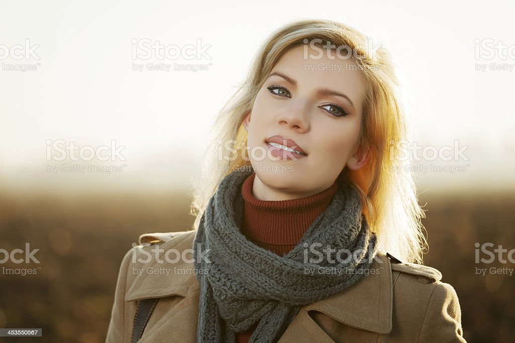 Blond woman against an autumn nature landscape royalty-free stock photo