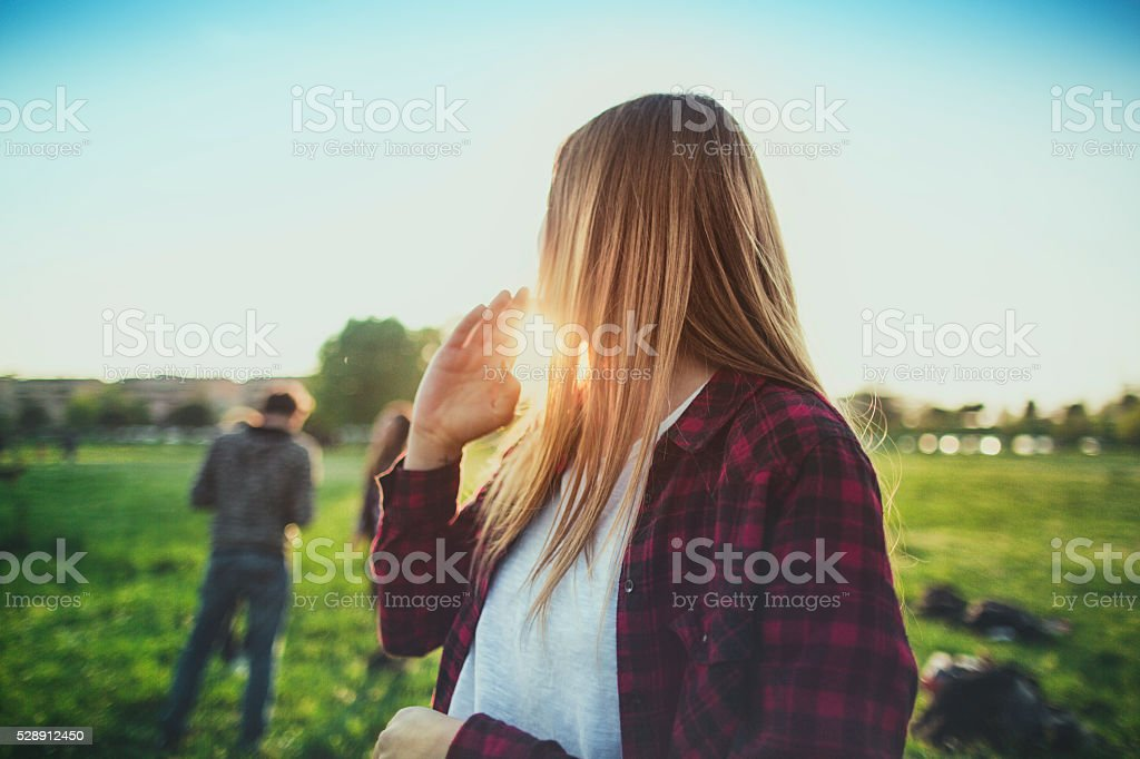 Blond woman and her friends enjoy the summer stock photo