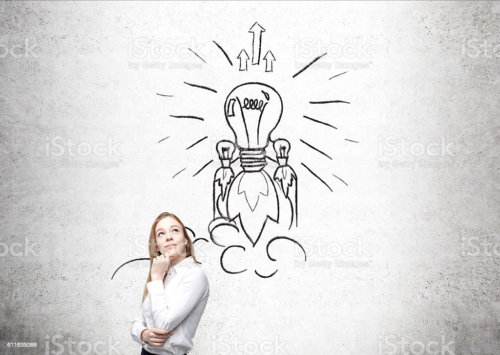 Blond woman and light bulb rocket stock photo