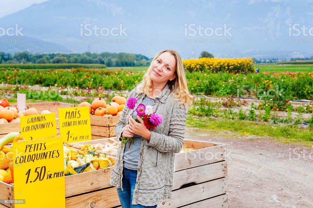 Blond woman at autumn countryside farm market stock photo