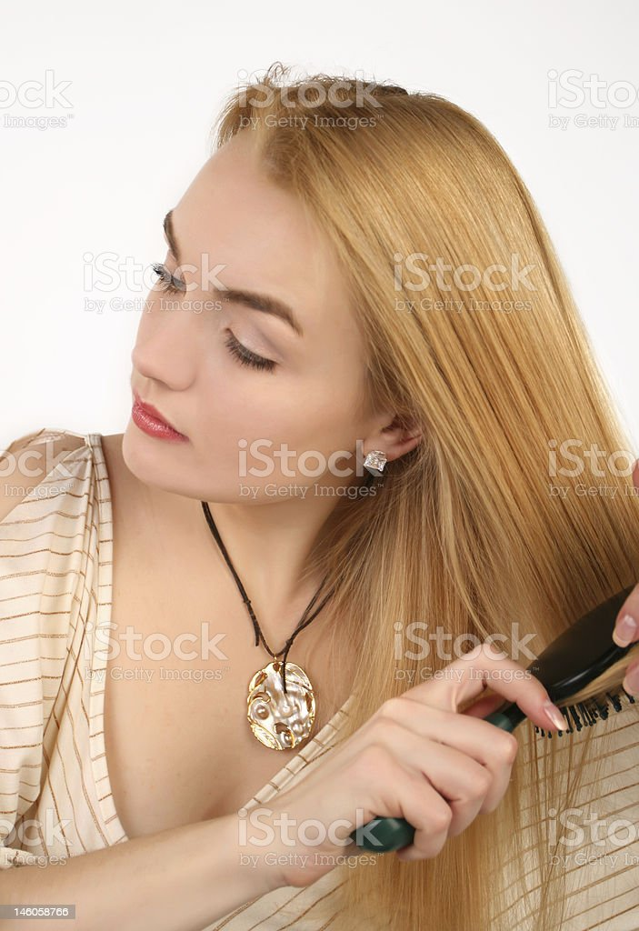 blond woman combing royalty-free stock photo
