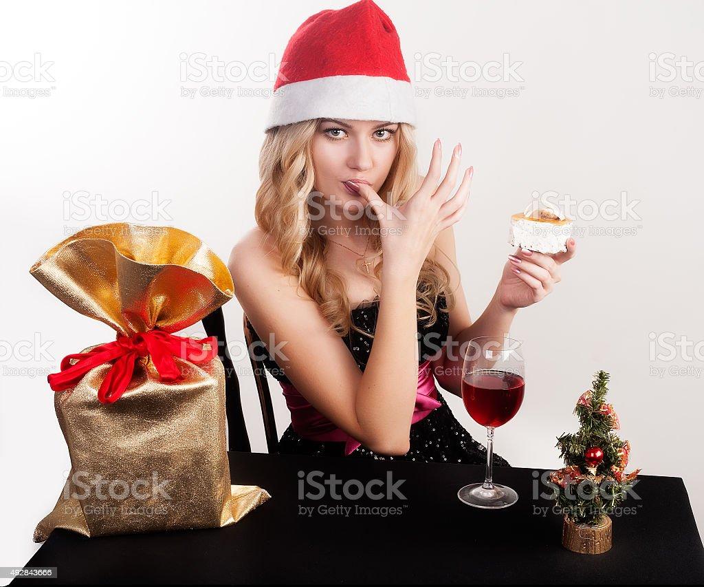 Blond woman eating cake stock photo