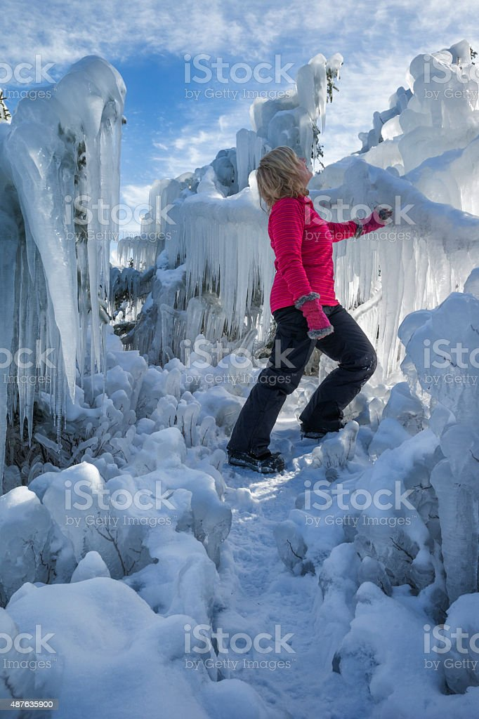 Blond woman explores a frozen fairyland stock photo