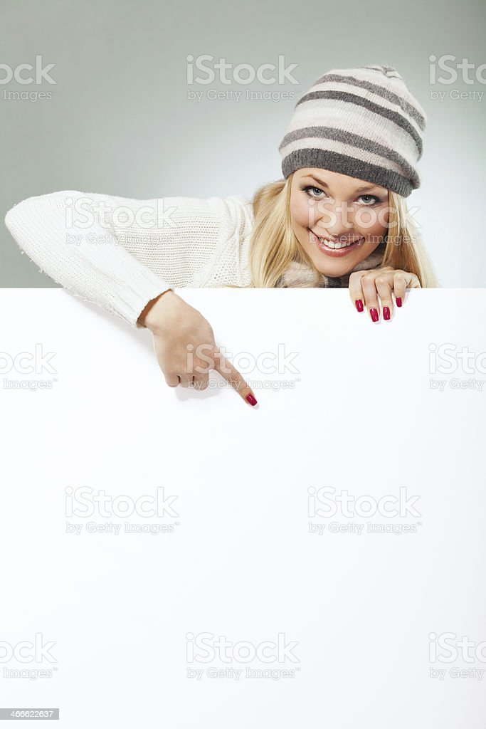 Blond woman holding blank banner. royalty-free stock photo