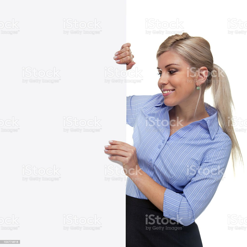 Blond woman holding the side of a blank sign board. royalty-free stock photo