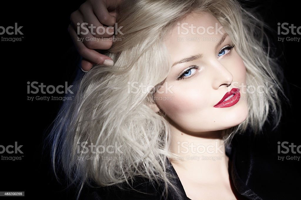 Blond Woman In Black stock photo