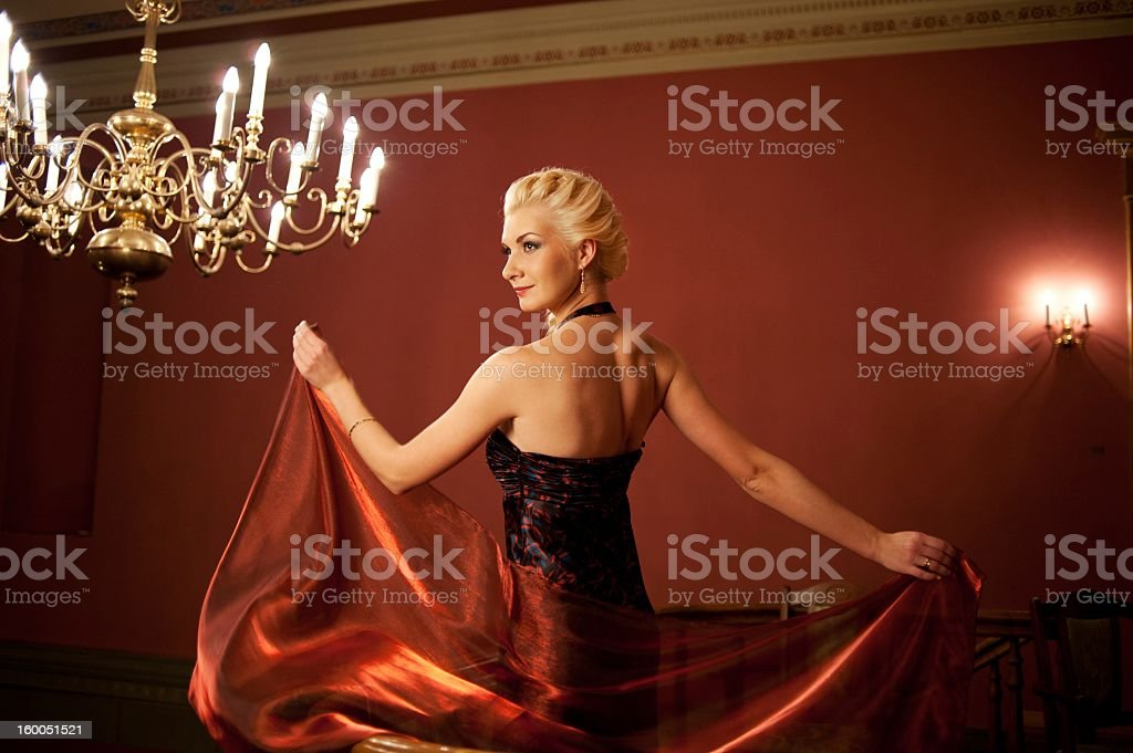 Blond woman in evening dress. stock photo