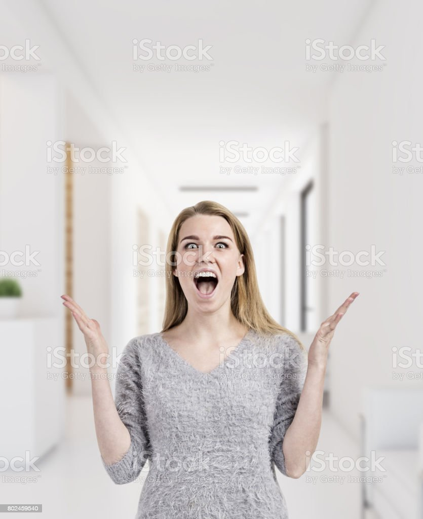 Blond woman is happy to work in office stock photo