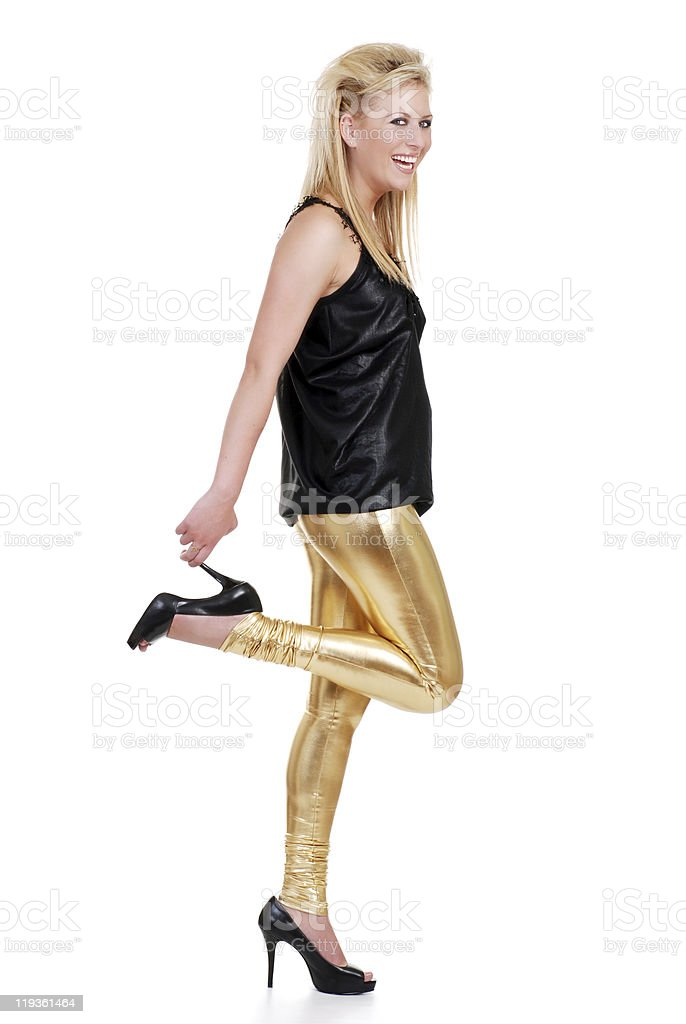 Blond Woman Laughing While Holding Her High Heel Shoe royalty-free stock photo