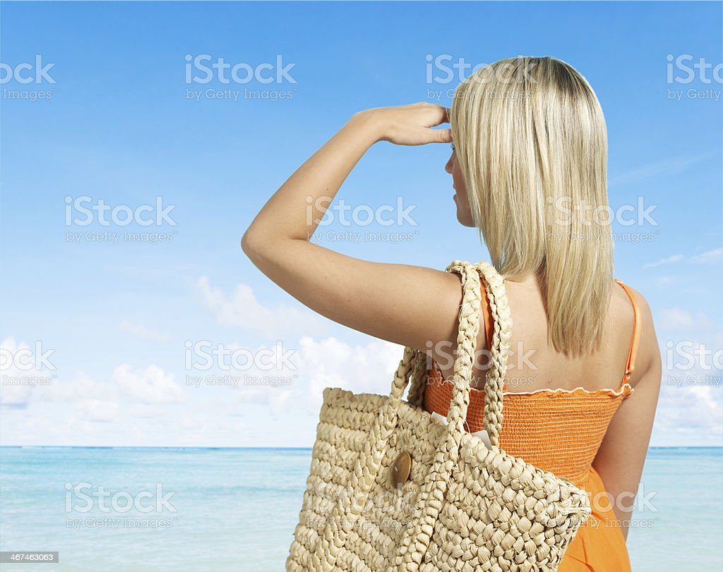 Blond Woman Looking at View on Beach stock photo