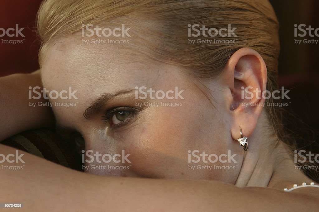 Blond woman lying on her arms royalty-free stock photo