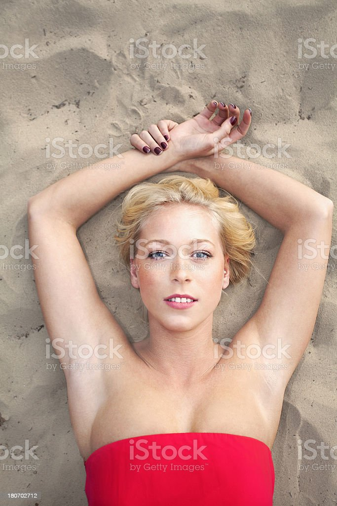 Blond woman lying on the beach portrait royalty-free stock photo