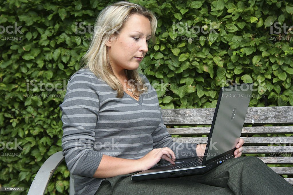 blond woman on laptop royalty-free stock photo