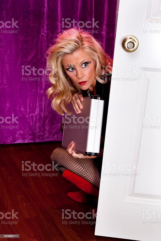 Blond Woman spy with metal case. stock photo