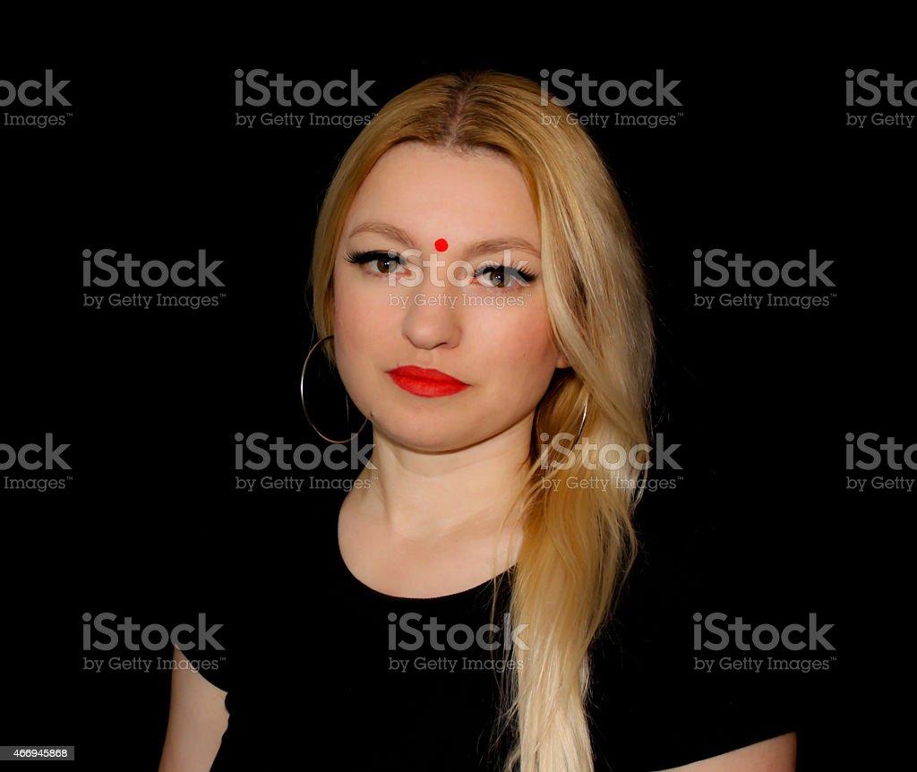 Blond woman wearing bindi stock photo