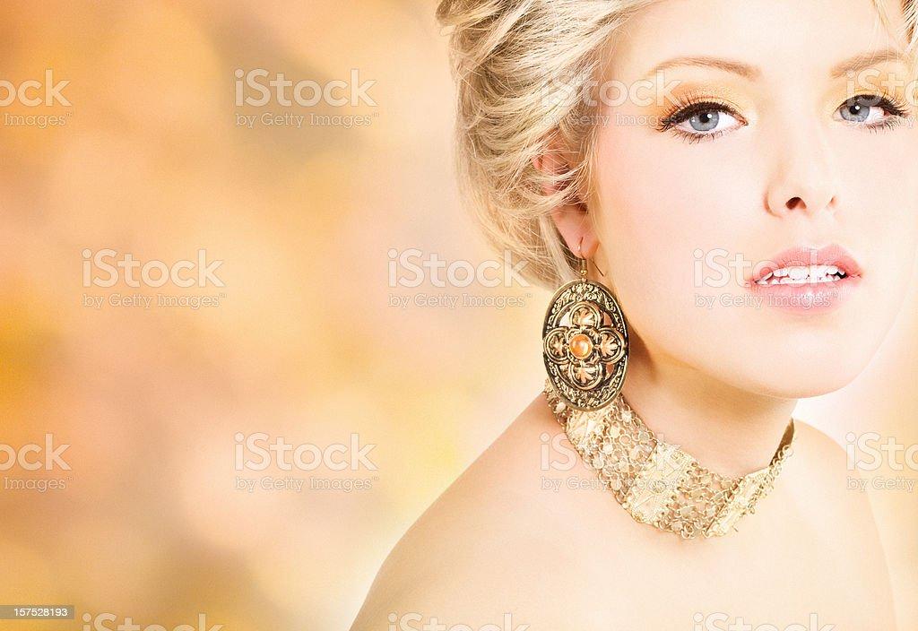 blond woman wearing jewelry stock photo