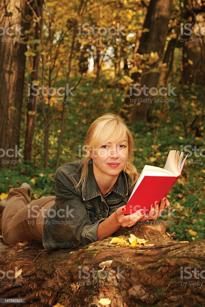 Blond woman  with a book royalty-free stock photo