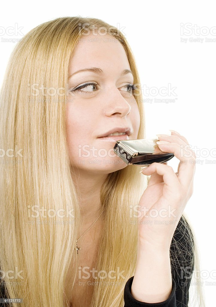 blond woman with a harmonica stock photo