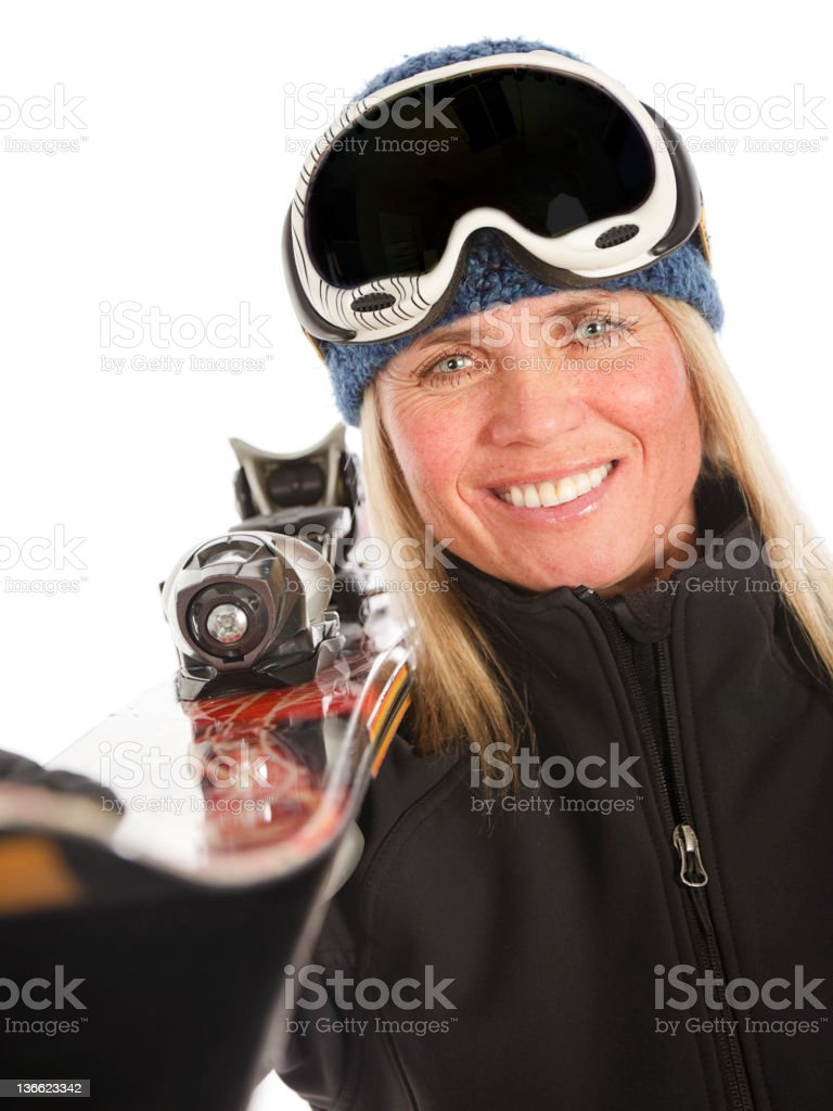 Blond Woman with Downhill Skis stock photo